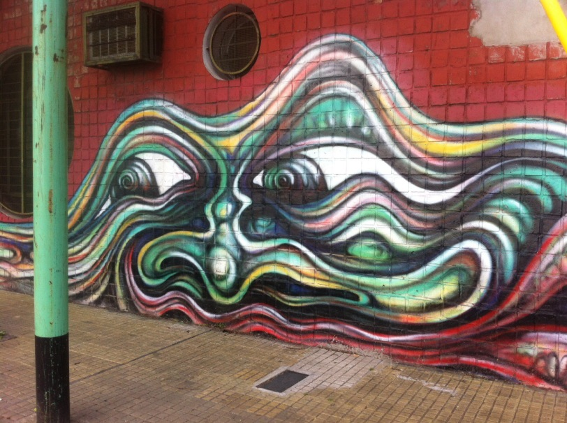 masque grimacant buenos aires street art